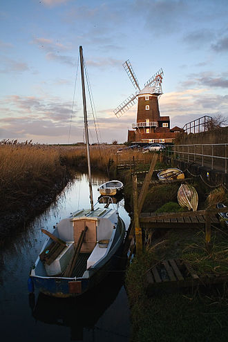 Cley next the Sea - Cley Towermill stands at the edge of village, next to the coastal marshes and a network of drainage channels