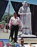 Cliff Fragua and his statue of Popé.jpg