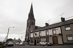 Collooney - Catholic church and Connolly's Bar.jpg