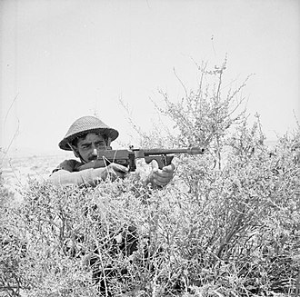 A soldier of the 4th Indian Division armed with a Thompson SMG, North Africa, 21 June 1941. Commonwealth Forces in North Africa E3661.jpg