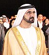 Consul General Waller, Deputy Secretary Nides, and the Ruler of Dubai Stand (cropped).jpg