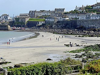Coverack - Coverack beach. The boats in the harbour can be seen in the background (2017).