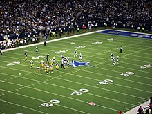 A photo of the Cowboys playing field with Packers and Cowboys on it.