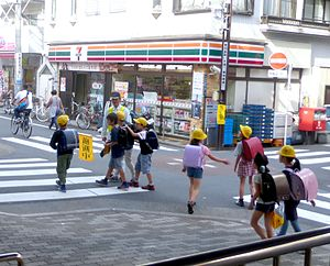 Crossing guard - A crossing guard and children in Japan