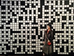 Crossword puzzle with lady in black coat.jpg
