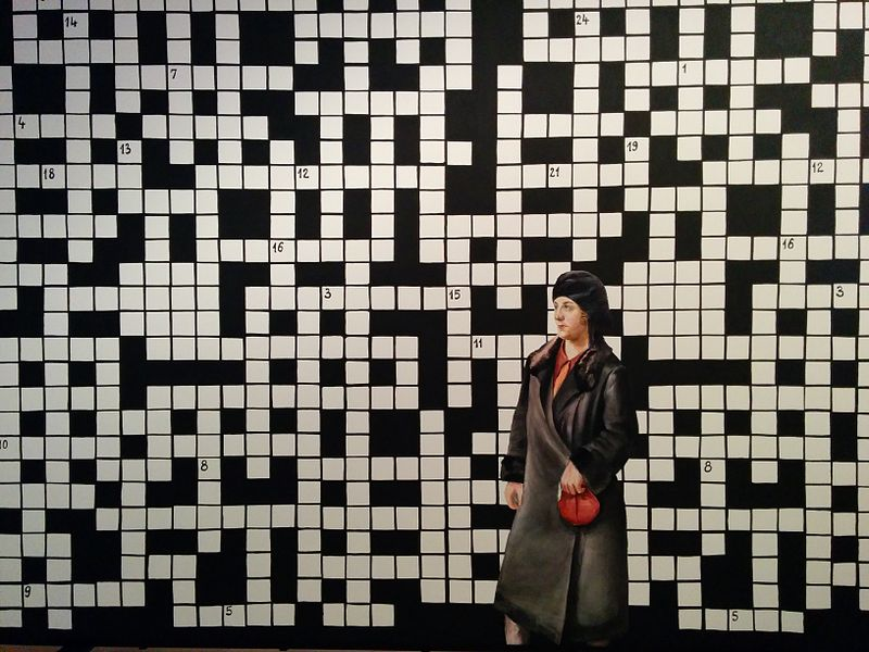 File:Crossword puzzle with lady in black coat.jpg