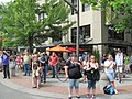 Crowds watching, especially through downtown (5932636200).jpg