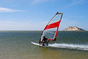 Dakhla, Western Sahara - Windsurfer and the Dragon Island in the background.