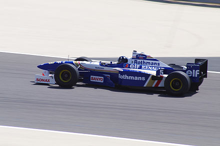 Hill demonstrating his championship-winning Williams FW18 car in 2010 Damon Hill Williams FW18 2010 Bahrain.jpg