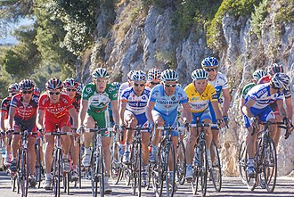 Paris–Nice - Davide Rebellin in the yellow leader's jersey with the peloton climbing the Col d'Èze in 2008.