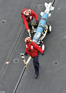 Defense.gov News Photo 110307-N-0569K-042 - Sailors move ordnance on the flight deck of the aircraft carrier USS Enterprise CVN 65 during flight operations while underway in the Red Sea on.jpg