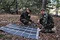 Defense.gov News Photo 110906-N-YO394-014 - Explosive Ordnance Disposal Technicians Petty Officer 3rd Class Matt Miga left and Petty Officer 2nd Class John Piowaty deploy a Power Management.jpg