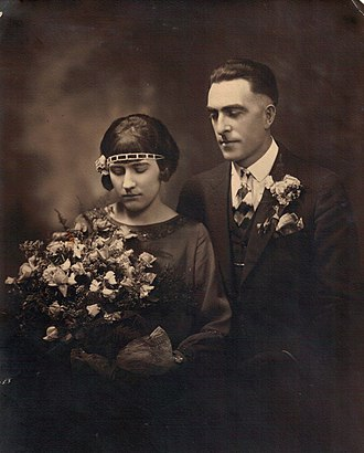 Bride - In the early 20th century, sometimes even later as here in 1926, it was not uncommon to see a bride wearing a darker-colored dress.