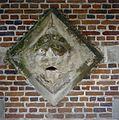 Detail van verweerde reliëfsteen in muur - Heeswijk - 20334330 - RCE.jpg