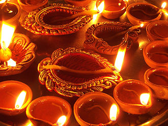 Worship in Hinduism - A tray of diya oil lamps, part of the Divali festival