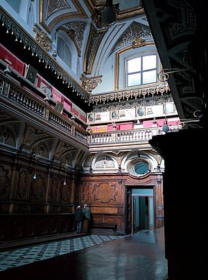 San Domenico Maggiore - Coffins of members of the royal Aragonese family (covered in red, upper level).
