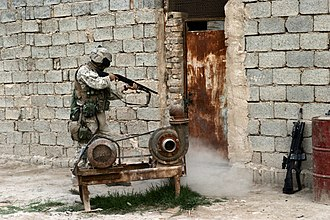 3rd Battalion, 8th Marines - A Marine from 3/8 breaching a door during Operation Iraqi Freedom.