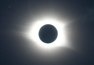 Solar eclipse of August 21, 2017 - Solar eclipse and star-system Regulus (upper left) viewed from Cullowhee, NC.