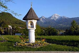 Lake Faak - Baroque shrine on the shore, view to Mt. Mittagskogel