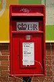 Elizabeth II postbox, Mistry Stores, Tong Road (geograph 5837525).jpg