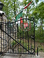 Estate of the Ministry of Foreign Affairs. Wrought iron gate, coat of arms and flags. - Budapest 12th district. Béla király út 32.JPG