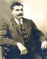 Eulalio Gutierrez sentado.png