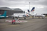 Extra Flugzeugbau EA300L and Two Regional Express (REX) SAAB 340B (VH-RXX and VH-RXE) on the tarmac at Wagga Wagga Airport.jpg