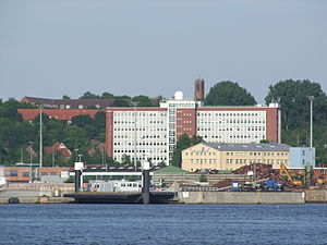 Fachhochschule Kiel - The high-rise building of the FH Kiel in Dietrichsdorf. It contains the departments for economics and social work. The foreground shows the Kieler Förde.