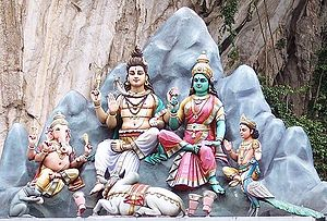 Parvati - Parvati with Shiva and sons Ganesha (leftmost) and Kartikeya (rightmost). Parvati is depicted with green complexion, denoting dark complexion.