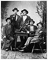 Fem midsommarfirande vägarbetare i ateljén. Vägbygget gick mellan Lima och Rörbäcksnäs, 1901-1905 - Nordiska Museet - NMA.0052748.jpg