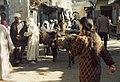 Fes slave quarter street scenes. Laden donkeys. (37086041843).jpg