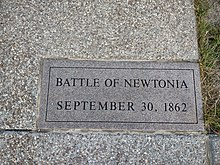 "Stone plaque reading ""Battle of Newtonia September 30, 1862"""