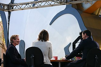First Take (TV series) - Skip Bayless (left), Dana Jacobson (center), and guest Jay Feely (right) at an outdoor broadcast of the show at Disney's Hollywood Studios in 2010