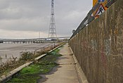 Flood wall towers over the riverside path - geograph.org.uk - 1594070.jpg