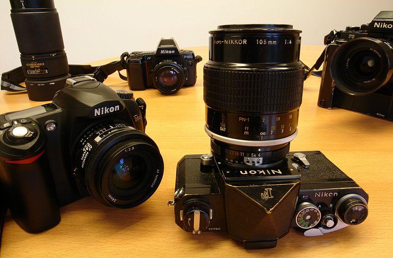 File:Four generations of nikon cameras.jpg