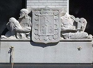 """Film Exchange Building - Two figures laced in film; the one on the right holding a film projector. The relief showing """"FEB"""" is also surrounded by film stock."""