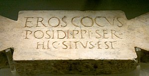 "Baths of Diocletian - Funerary stele of a cook. Latin inscription: ""Eros, cocus Posidippi, ser(vus) hic situs est"" (""Eros, Posidippus' cook, slave, lies here"")."