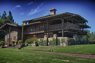 Gamble House (Pasadena, California) - Exterior view from front lawn, showing southwest-facing front door and front gable.
