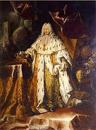 An elderly peri-wigged man is resplendent in gold, ermine-fringed coronation robes.