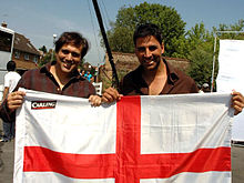 Govinda and Akshay Kumar holding an English flag