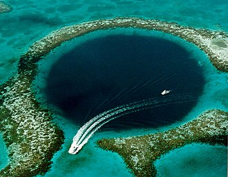 The Great Blue Hole off the coast of Belize is a prime ecotourism destination. It is a UNESCO World Heritage Site Great Blue Hole.jpg