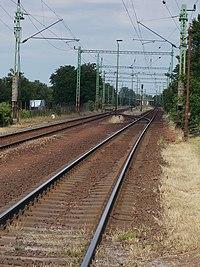 Gyömrő train station from Szent István Street's level crossing, Pest County, Hungary.jpg
