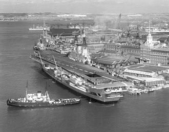 HMS Eagle (R05) - At Portsmouth's South Railway Jetty after the 1964 rebuild, with remodelled island