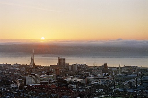Haar approaching Dundee city centre across River Tay at Sunrise late 1998 from Law