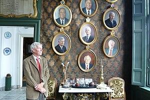 Hofje van Noblet - A regent of the hofje posing next to his portrait in the regent's room of the Hofje van Noblet.