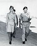 Habis Majali walking alongside Queen Alia.jpg