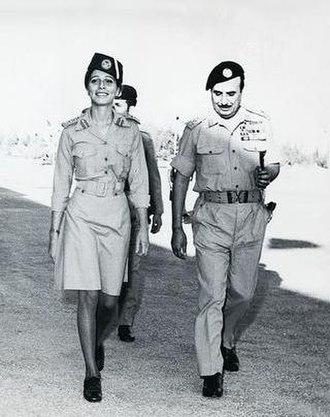 Alia Al-Hussein - Queen Alia walking alongside Jordanian Army Chief of Staff Habis Al-Majali, 1960s.