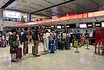 Hainan Airlines economy class check-in counters at ZBAA T1 (20180816064545).jpg