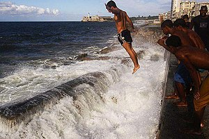 English: Havana, Cuba - Kids diving into the A...