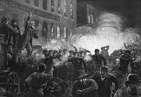 This 1886 engraving was the most widely reproduced image of the Haymarket Affair. It inaccurately shows Fielden speaking, the bomb exploding, and the rioting beginning simultaneously[1] - Haymarket affair